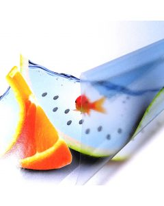 A closeup of a peeled sheet of A4 self-adhesive inkjet printable glossy transparent vinyl label. This sheet has an abstract printed picture of 2 goldfishes swimming in a watermelon shell and orange peel slices. Close up is focused on the goldfish inside t