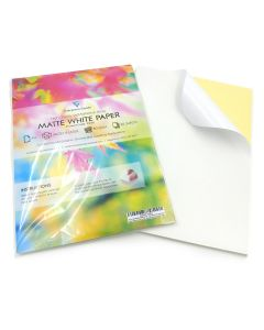 A stack of A4 self-adhesive inkjet & laser printable matte white paper label with the sheet at the top peeling. A separate stack with the front cover and packaging is placed on top.